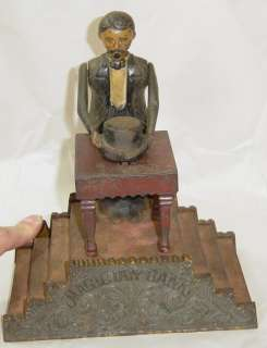 Antique J&E Stevens Magician Mechanical Cast Iron Bank